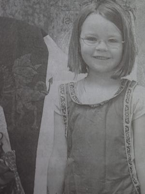 Brenna Cleavanger played dress-up at the Union County Public Library Summer Reading program in July 2009.
