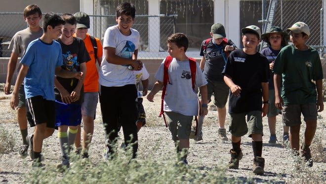 A group of Boy Scouts interact during the First Aid/Emergency Preparedness Zombie Apocalypse Weekend at the Elks Lodge in Desert Hot Springs.