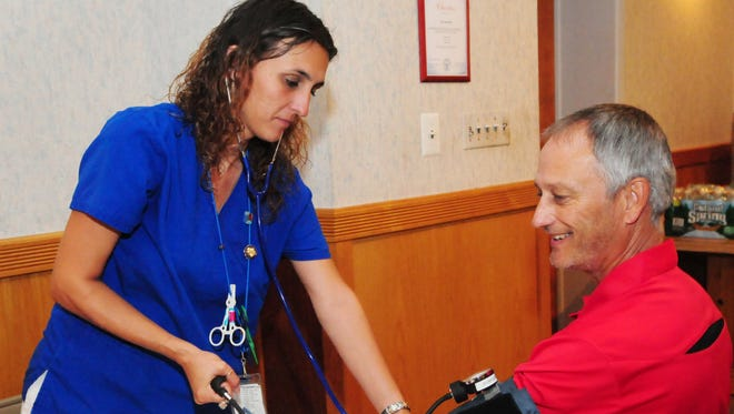 Bob Harris, of Belleville, gets his blood pressure checked by Community Blood Services phlebotomist Bernadett Kalla,  prior to donating at the Elks blood drive on Wednesday, Aug. 26, 2015.