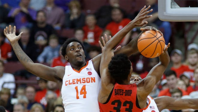 Clemson's Elijah Thomas, left, blocks the shot of Ohio State's Keita Bates-Diop during the first half of an NCAA college basketball game Wednesday, Nov. 29, 2017, in Columbus, Ohio.
