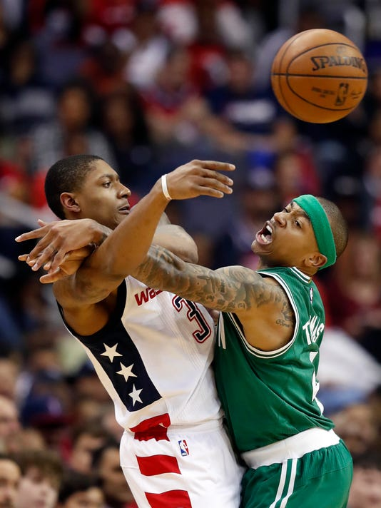 Washington Wizards guard Bradley Beal (3) passes the ball over Boston Celtics guard Isaiah Thomas (4) in the second half of Game 6 of an NBA basketball second-round playoff series, Friday, May 12, 2017, in Washington. The Wizards won 92-91. (AP Photo/Alex Brandon)