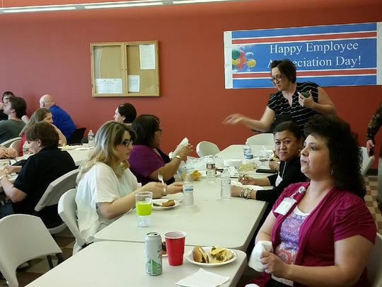 Doña Ana County employees eat hot dogs, veggie burgers and nachos during an Employee Appreciation Day lunch on Friday.