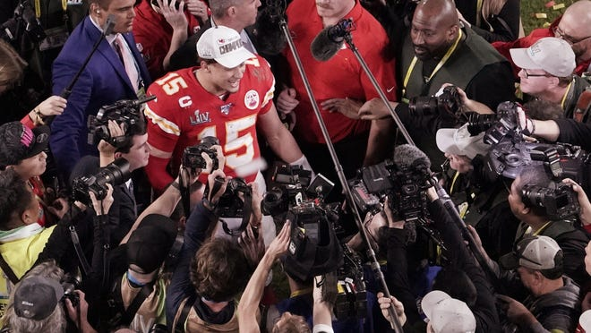Kansas City Chiefs quarterback Patrick Mahomes, surrounded by media after the Super Bowl win over the San Francisco 49ers, has signed a 10-year, $503 million extension with the Chiefs.