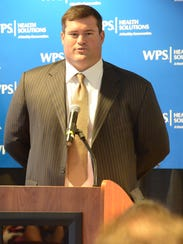 Former offensive lineman Chad Clifton talks to media