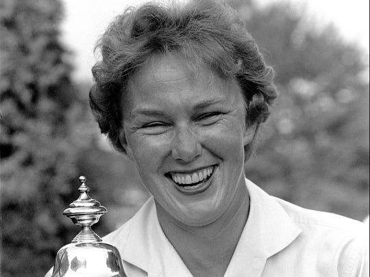 In this July 1, 1961 file photo, Mickey Wright poses after winning her third Women's National Open, at the Baltusrol Golf Club at Springfield, N.J. Wright died Feb. 17, 2020, of a heart attack, her attorney told the AP. (AP Photo/File)