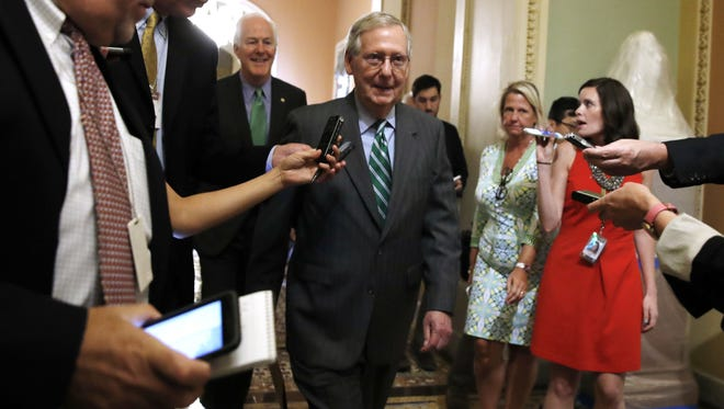 Senate Majority Leader Mitch McConnell, followed by Majority Whip John Cornyn, leaves a Republican meeting on health care on June 22, 2017, on Capitol Hill.