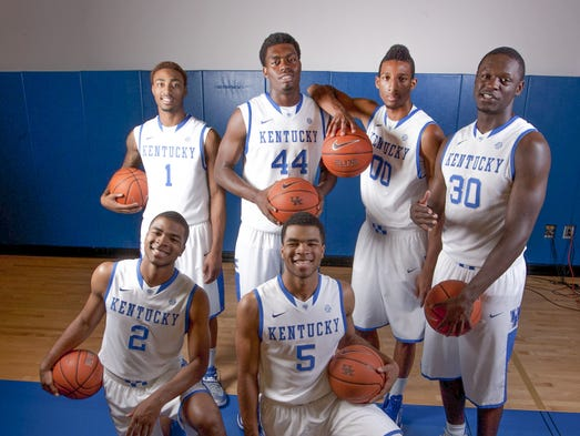 Kentucky freshmen James Young (1), Dakari Johnson (44), Marcus Lee (00), Julius Randle (30), Aaron Harrison (2) and Andrew Harrison (5) pose during Kentucky Media Day at the Joe Craft Center.