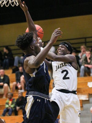 T.L.Hanna sophomore guard Issiah Norris shoots near Spartanburg center Adrian Briscoe during the first quarter on Saturday at T.L. Hanna High School in Anderson.