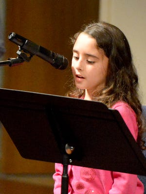"Third-grader Ava Crawford of Ware Elementary reads her poem, ""Blue Green and Super Mean!"" She wrote her poem, inspired by Benjamin Britten's ""Marcia, from Suite No. 3 for Solo Cello.""  The Staunton Music Festival sponsored ""The Writer's Ear,"" featuring student poetry and stories as well as the five classical works that inspired them as part of a free concert held on the campus of Mary Baldwin College on Sunday, March 2, 2014."