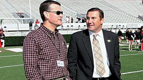 Mississippi State athletic director Scott Stricklin (left) refuted a reporter he had signed a deal with Baylor for a football series.