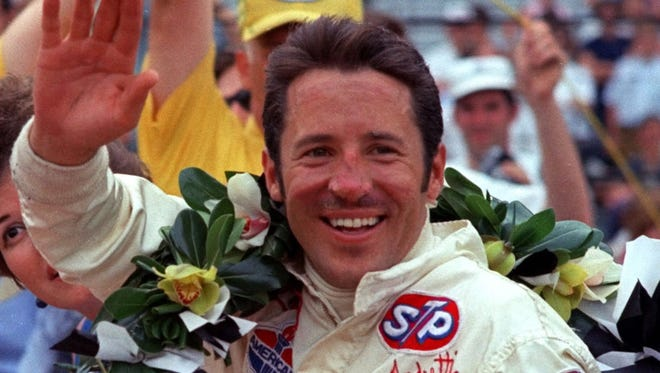 Mario Andretti waves from the winner's circle after winning the Indianapolis 500 in this May 1969, photo at the Indianapolis Motor Speedway.