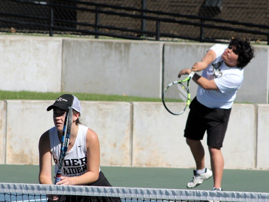 Sean Valverde serves during the mixed doubles third-place