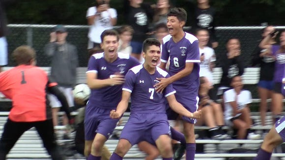 New Rochelle's Johan Velez  (7) celebrates with teammates