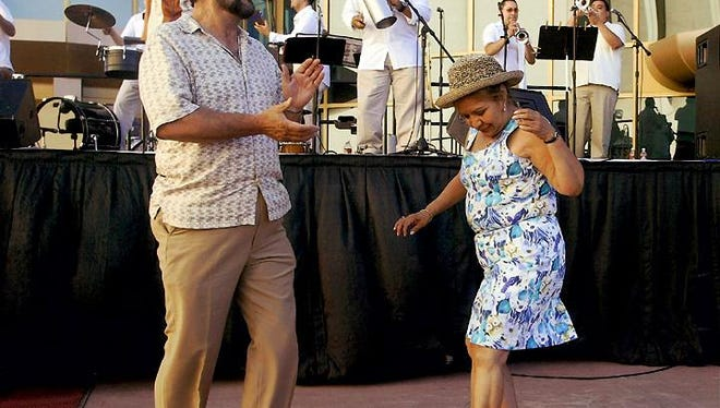 Event-goers dance to live music at Alfresco! Fridays in Downtown.
