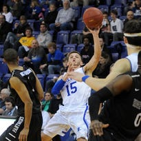 Andrew Rowsey scores two of his 21 first-half points for UNC Asheville on Thursday night.