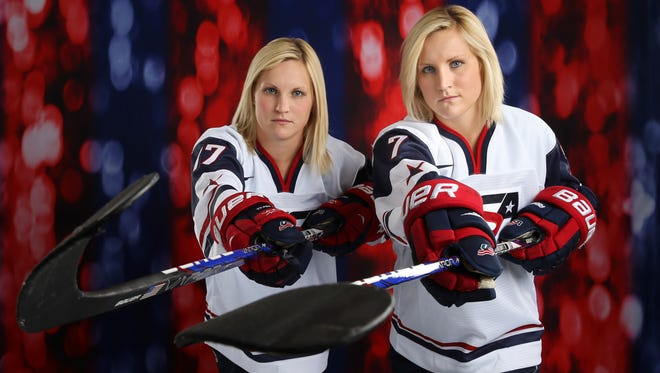 USA women's hockey forward Monique Lamoureux, right, poses with her sister Jocelyne during a portrait session at the Team USA Media Summit at Canyons Grand Summit Hotel.
