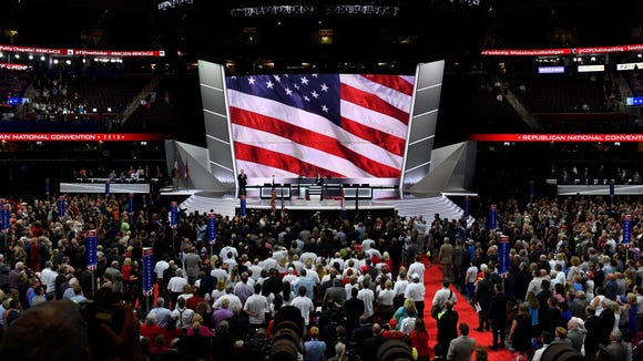 Delegates in the hall say the Pledge of Allegiance