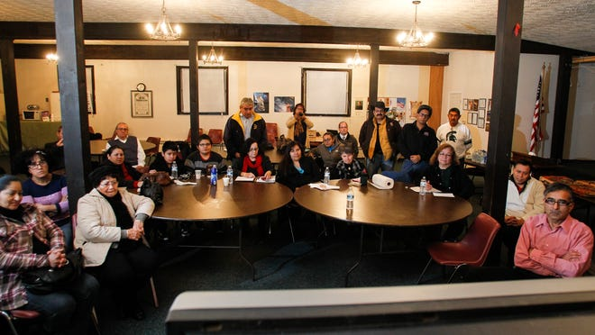 About 30 people at Cristo Rey Church in Lansing watch President Obama on television Thursday as he announces an executive order to ease some immigration restrictions.
