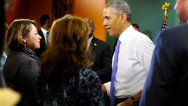 Karla Ruiz speaks with President Barack Obama as he ends his visit.