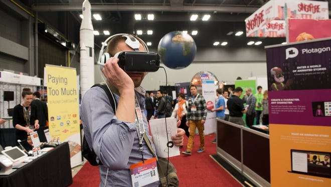 Dag Otter Johansen from Norway tries out virtual headsets at the Marxent booth, a company which builds augmented reality- virtual reality apps, at the SXSW Tradeshow at the Austin Convention Center on March 15, 2015.