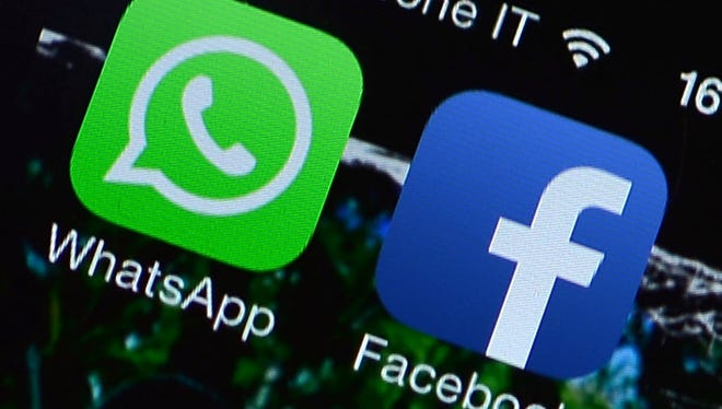 Wall Street reacts to Facebook first-quarter results. The Facebook and WhatsApp applications' icons are displayed on a smartphone on February 20, 2014.