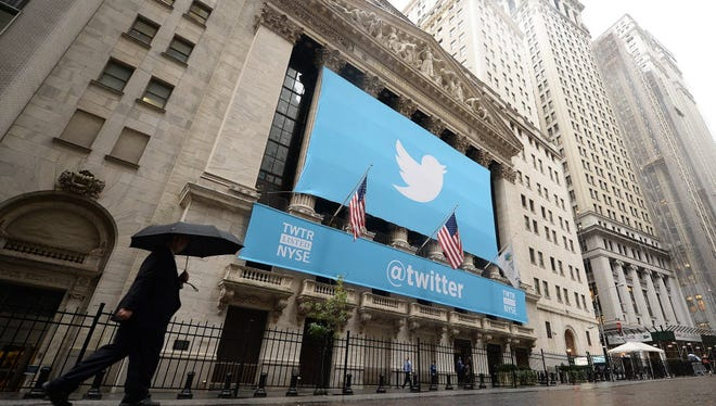 A banner with the Twitter logo adorns the New York Stock Exchange (NYSE) in New York City on Nov. 7, 2013.
