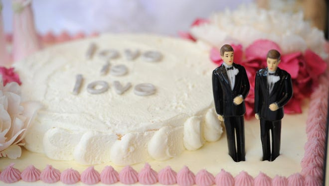 A wedding cake with a male couple on July 1, 2013, in West Hollywood, California.