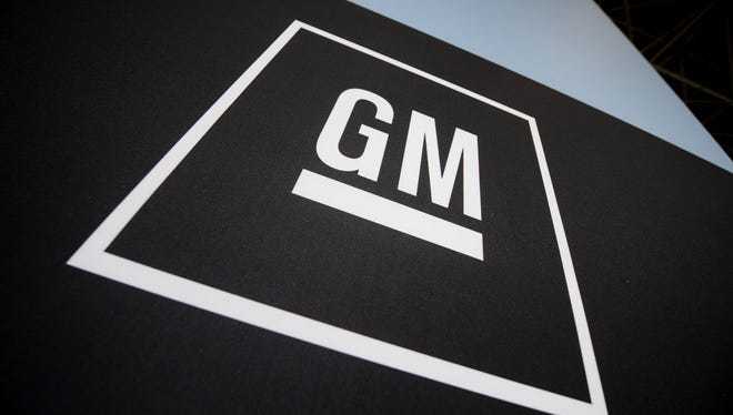 This April 8, 2009 file photo shows the General Motors logo is displayed at the New York International Auto Show in New York.