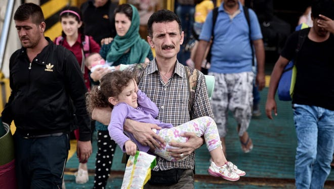 Syrian refugees arrive in Piraeus, Greece, on Sept. 9, 2015.