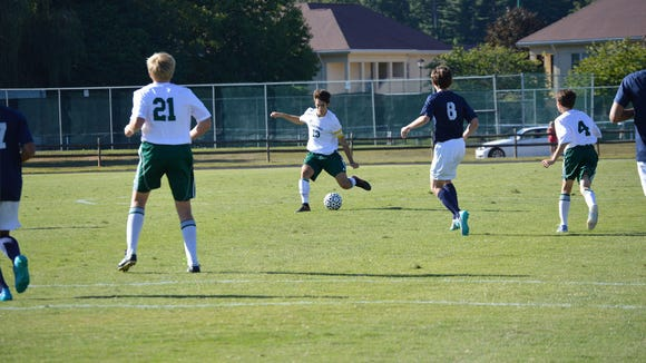 Christ School's Young Perry (13) has committed to play college soccer for Wofford.