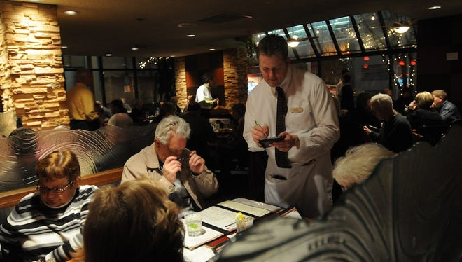 Patrons dine at McGrath's Fish House in downtown Salem in 2010. Rudy's Steakhouse will move into the Chemeketa space in July.