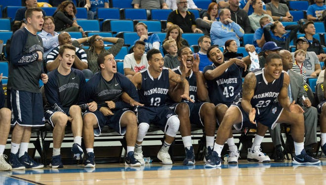 Monmouth University players react on the bench during the closing minutes of its 84-81 win at UCLA on Friday evening