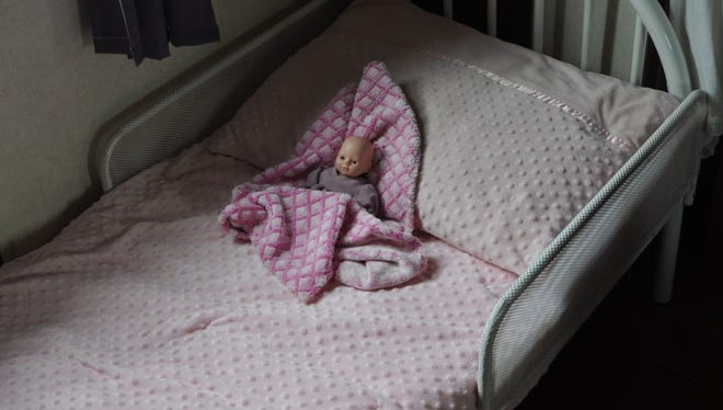 Julia's little white bed, pictured here, was move into Gloria and Daniel's room while her uncle took up residence for awhile.