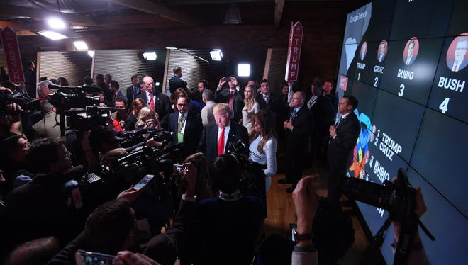 "Donald Trump talks to media in the ""spin room"" after Feb. 13, 2016 debate in Greenville, S.C."