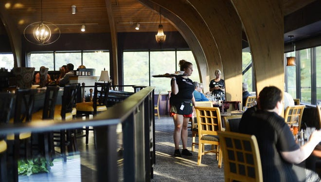 Patrons eat with a view of the golf course at oak. restaurant at Heritage Hills Golf Resort n York Township.