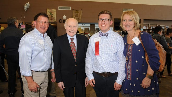 Sam Meier is pictured with his father, Wayne, at left, his mother, Heather, at right, and former Senator Herb Kohl.