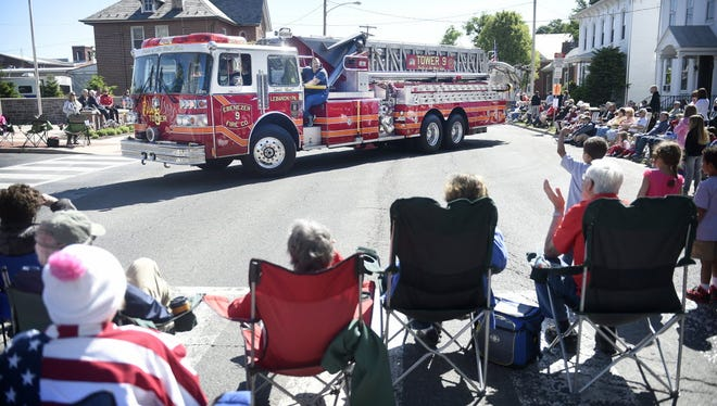 Spectators watch a fire truck in Annville's annual Memorial Day Parade in this photo taken in 2015. The 2016 parade begins at 9 a.m. Saturday and features eight divisions.