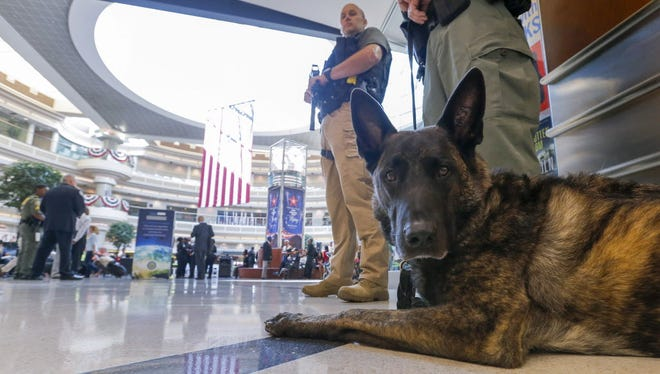 A K-9 unit joins other heavily armed Atlanta Police officers standing guard ahead of the Fourth of July weekend at Hartsfield-Jackson Atlanta International Airport, in Atlanta, Georgia on June 30, 2016.