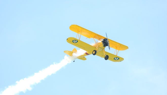 A Stearman aircraft takes flight during the Pensacola Beach Air Show.