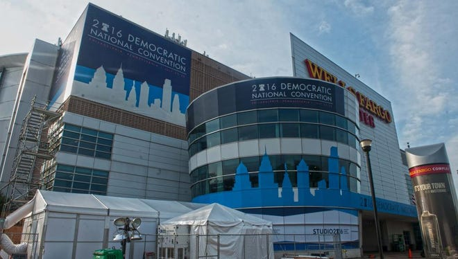 A general view of work and banners on the exterior of Wells Fargo Arena in advance of the 2016 Democratic National Convention.