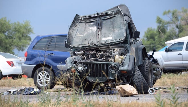 A damaged Jeep sits in the road following a crash on East Mulberry Street on Thursday afternoon.