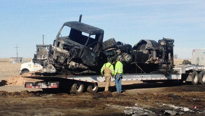 This photo, courtesy of KFDA NewsChannel 10 in Amarillo shows the charred remains March 11, 2013, after a fatal wreck the day before between a tanker loaded with fuel and a car with five teens near Dumas, Texas. The deaths of the five Texas teens came the same day as an accident in Ohio that killed six and a day before a crash in Illinois killed four. Three teenagers died Friday in Indiana when police said the drivers of two pickups ran a four-way stop and collided.