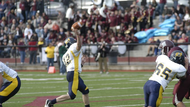 Quarterback Nick Herrmann attempting pass in Belleville's 2009 Thanksgiving game against Nutley