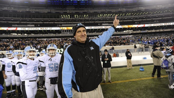 Mahwah head coach Jeff Remo celebrates after winning last year's North 1, Group 2 title at MetLife Stadium.