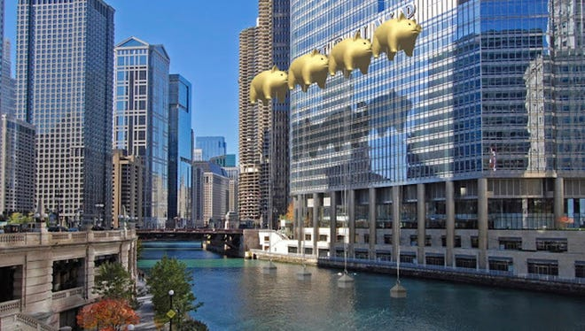 This image provided by New World Design Ltd. shows a rendering of four giant pig balloons covering up the Trump name on the side of the president-elect''s Chicago hotel, that an architect wants to install.
