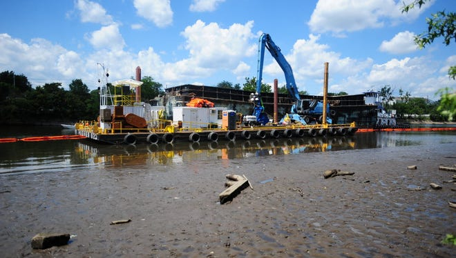 Crews work in 2013 to dredge dioxin-laden sediment in the Passaic River next to Riverside County Park in Lyndhurst.