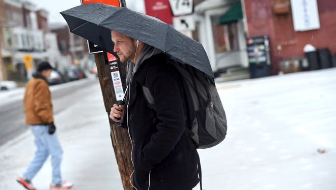 Some people took cover from the mix of snow and sleet in York County this morning.