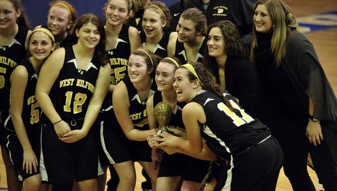 The West Milford girls' basketball team celebrates after winning last season's annual Butler Christmas Tournament.