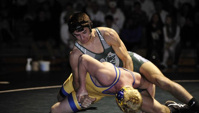 Senior Auston Tighe, top, and the Kinnelon wrestling team kick off the dual meet and conference schedule next week when rivals Butler comes to town for a key NJAC-Independence matchup.