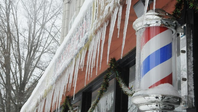 A barbershop facade has a nice array of icicles on Feb. 9 in Montclair. For more on the snow, see page 2.